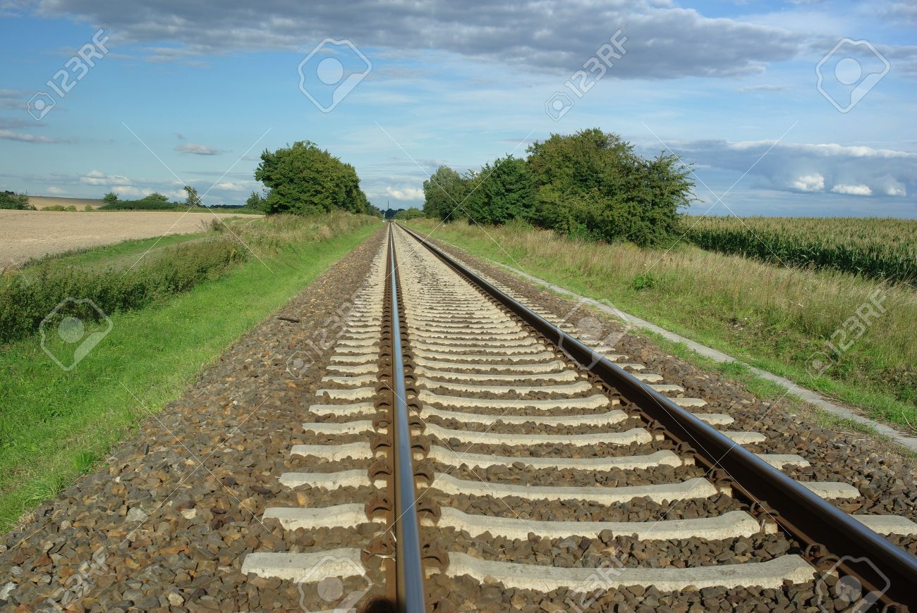 Railway Tracks On Background Of Scenery Stock Photo, Picture And